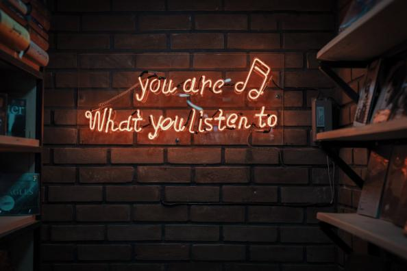 you are what you listen to sign on wall